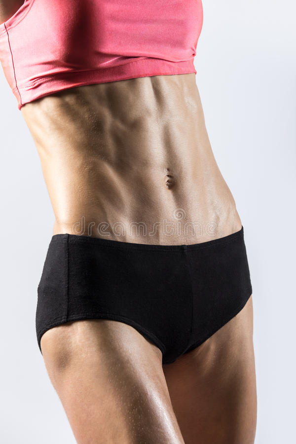 Close-up of abs of beautiful athletic woman stock images