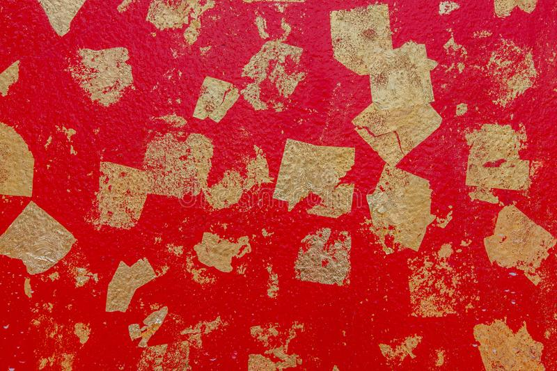 Abstract background texture red cement wall with gold foil attached. royalty free stock photography