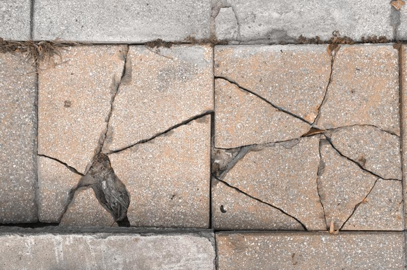 Close up abstract broken concrete footpath background stock images