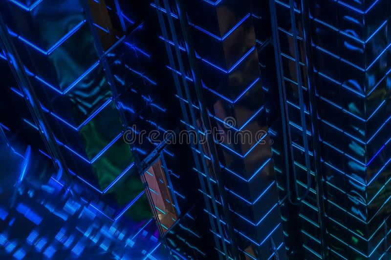 Close-up abstract of pattern of blue vivid led backlight walls of high glowing building, modern lighting of buildings royalty free stock photo