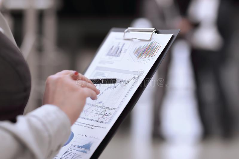 Close up. accountant checking the financial report. royalty free stock image
