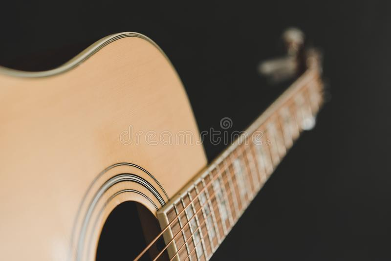 Close up of accoustic guitar. Close up of accoustic guita isolated on black background royalty free stock images