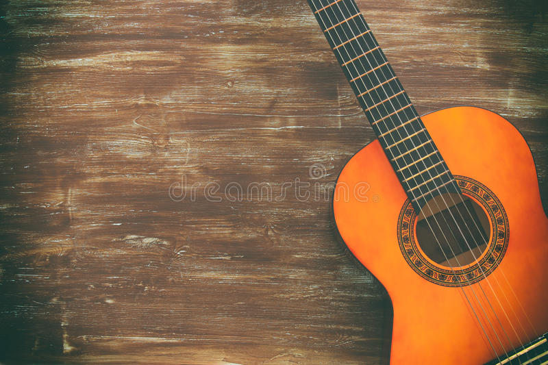 Download Close Up Of Acoustic Guitar Against A Wooden Background Stock Photo - Image of brown, beautiful: 91251942