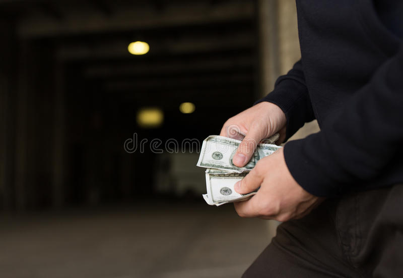 Close up of addict or drug dealer hands with money stock photography