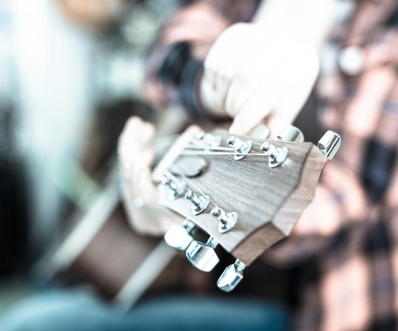 Adjustment of guitar pegs. Close up of the adjustment of guitar pegs royalty free stock image
