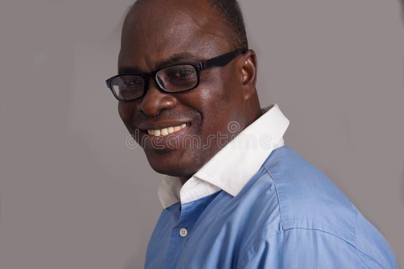 Close up of an adult african man, smiling stock photos