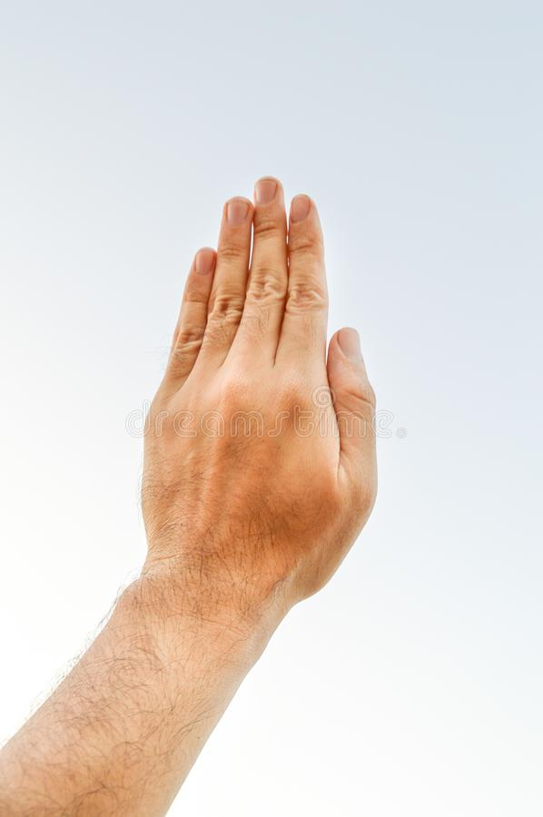 Adult hand reaching out towards the sky royalty free stock photo