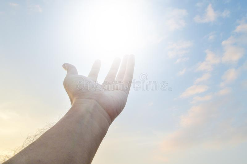 Adult hand reaching out towards the sky royalty free stock images