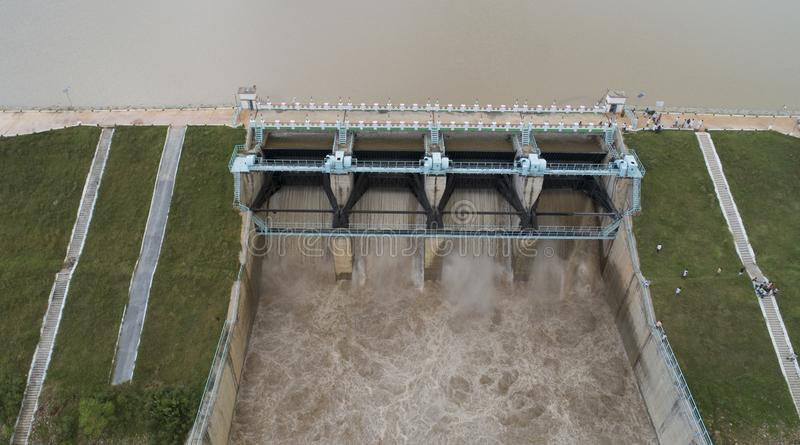 Close up Aerial bird eye of water reservoir flood gates open to release water from dam at raichur, India.  royalty free stock photos