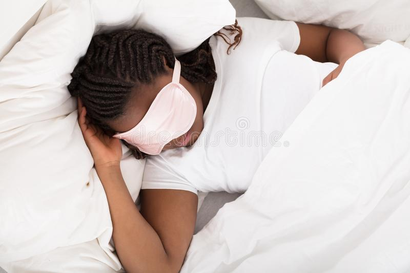 African Girl Sleeping In Bed royalty free stock image