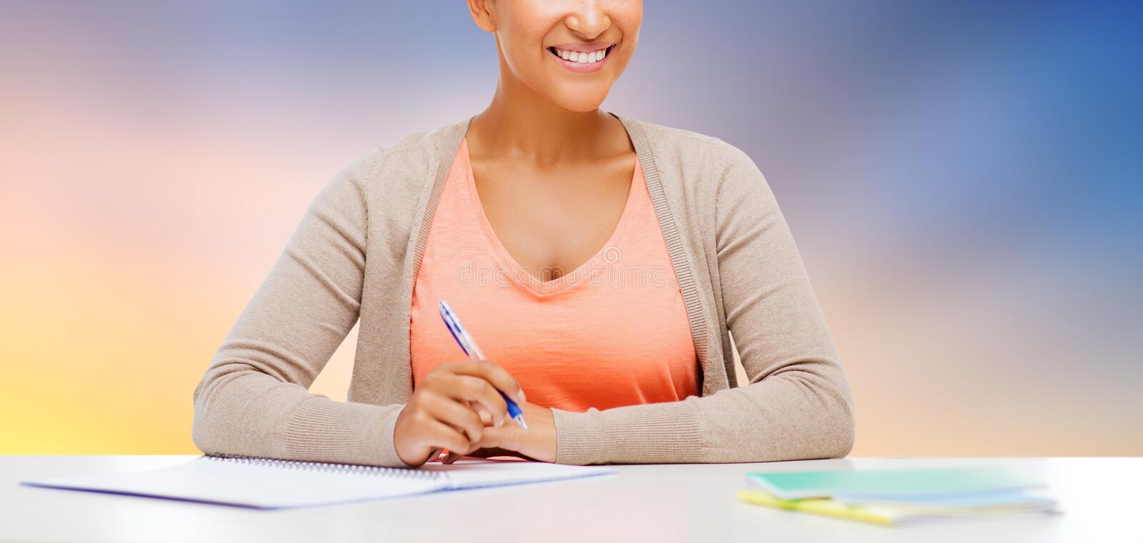 Close up of african student girl with notebook stock photography