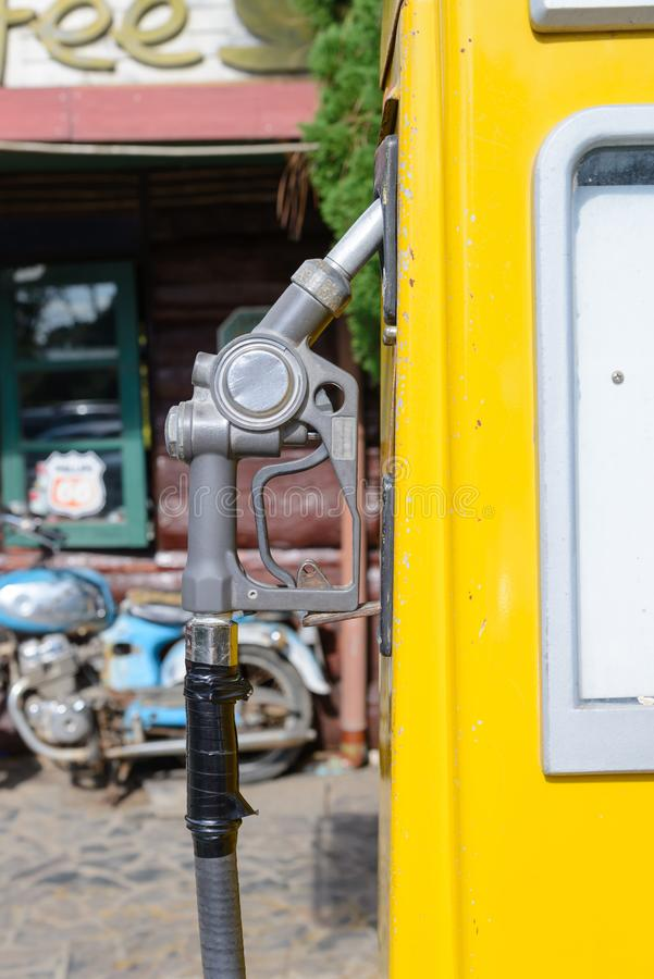 Aged and worn vintage petrol pump filling nozzles, Old gas station stock photos