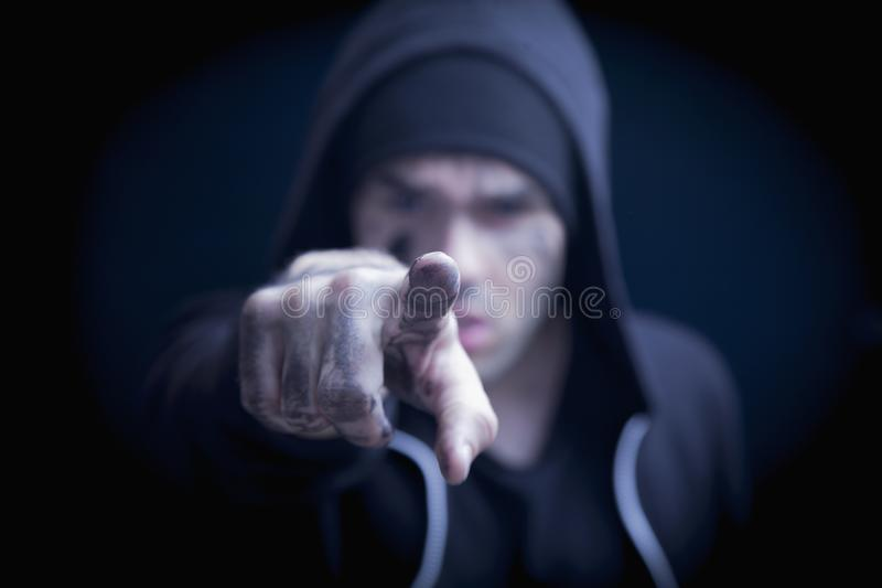 Close up agressive man pointing at you as if she wants to say: That applies to you, too. Robbery and konflict concept. Selective stock photography