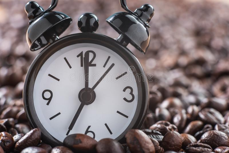 Close-up of alarm clock. On coffee beans, serve for waking up royalty free stock images