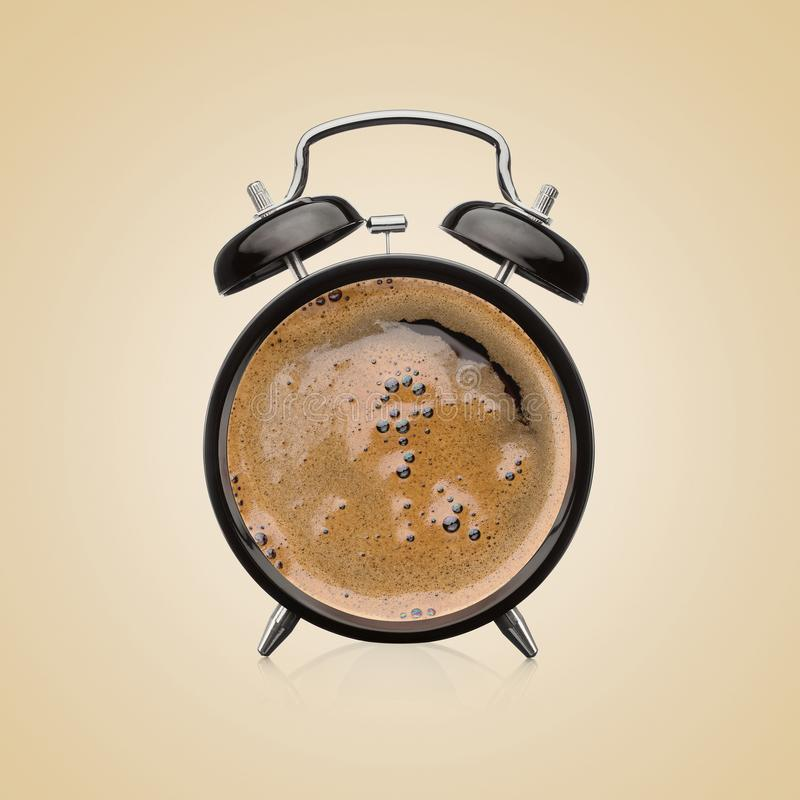 Alarm clock and coffe cup combined together royalty free stock photo