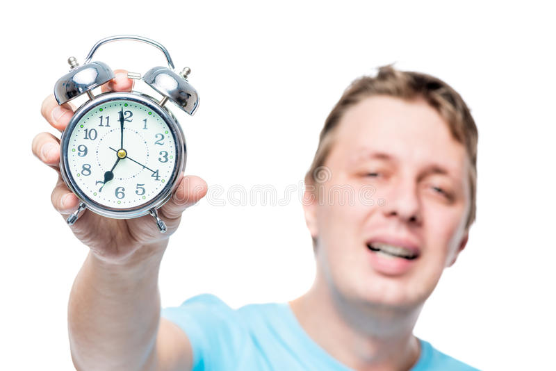 Close-up of an alarm clock in a male hand stock images