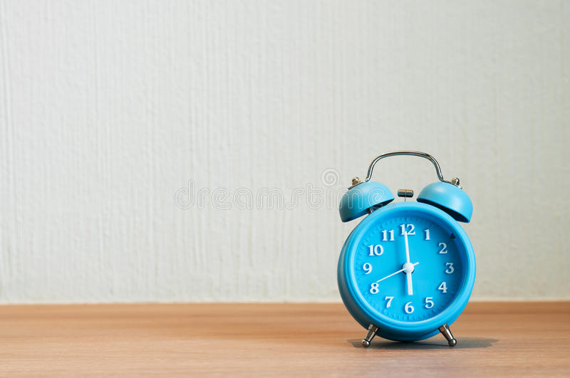 Close up of alarm clock on wooden table. stock photos