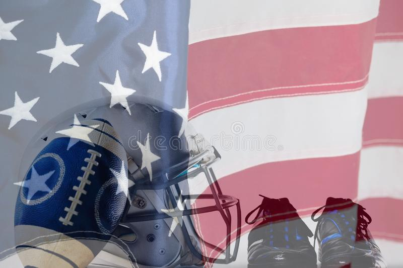 Composite image of close up of america football and helmet by sports shoes. Close up of America football and helmet by sports shoes against close-up of an stock photography