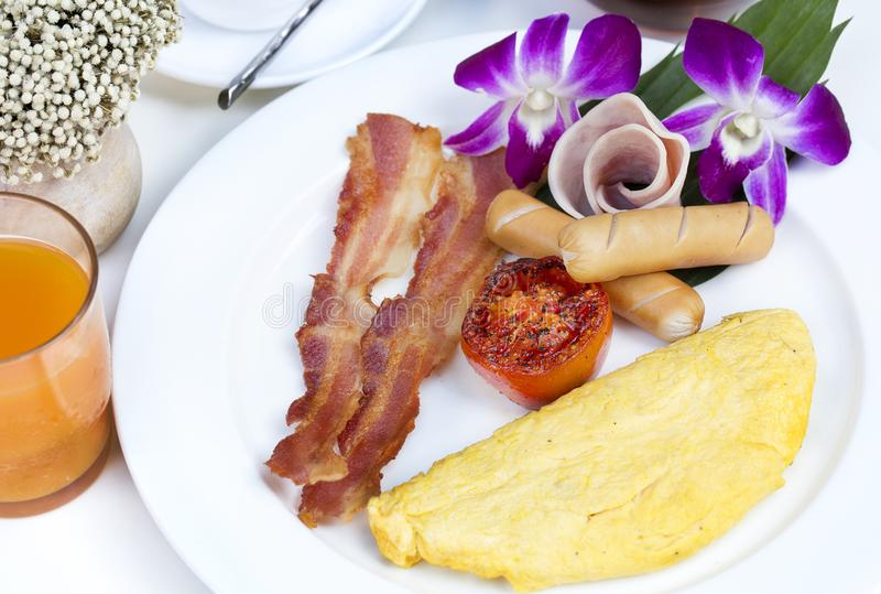 Close up American Breakfast with omelette,bacon and sausage. royalty free stock image