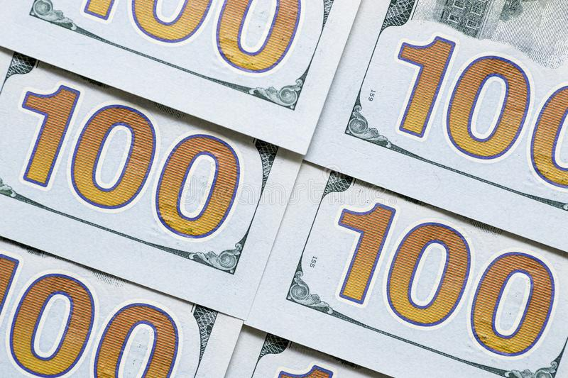 Close-up american dollar banknotes. One hundred dollars. Money US dollars banknotes, a lot of money. Fragments of $100 banknotes royalty free stock images
