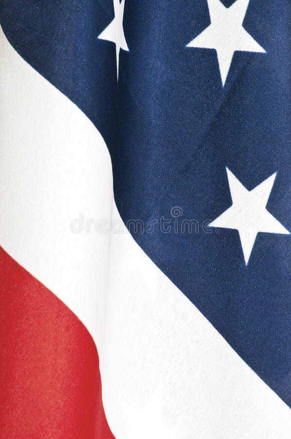 Close-up of American flag. Closeup of an American flag showing the red, white and blue with some of the stars royalty free stock image