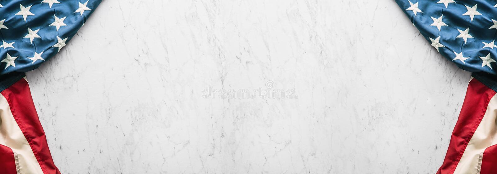 Close-up american flag on white marble background royalty free stock images