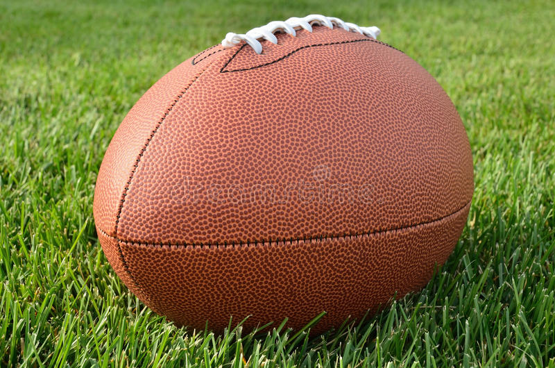 grass american football field. Download Close Up Of An American Football On Grass Field Stock Photo - Image Nobody