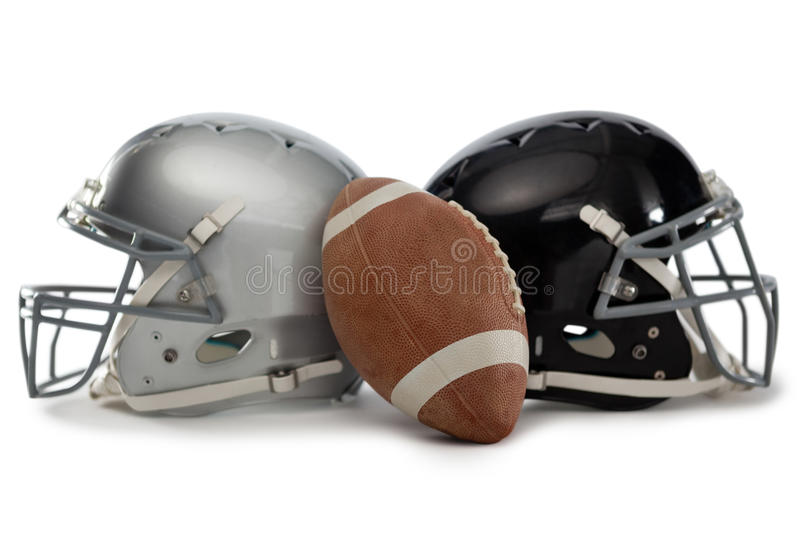 Close up of American football with helmets. On white background royalty free stock photo