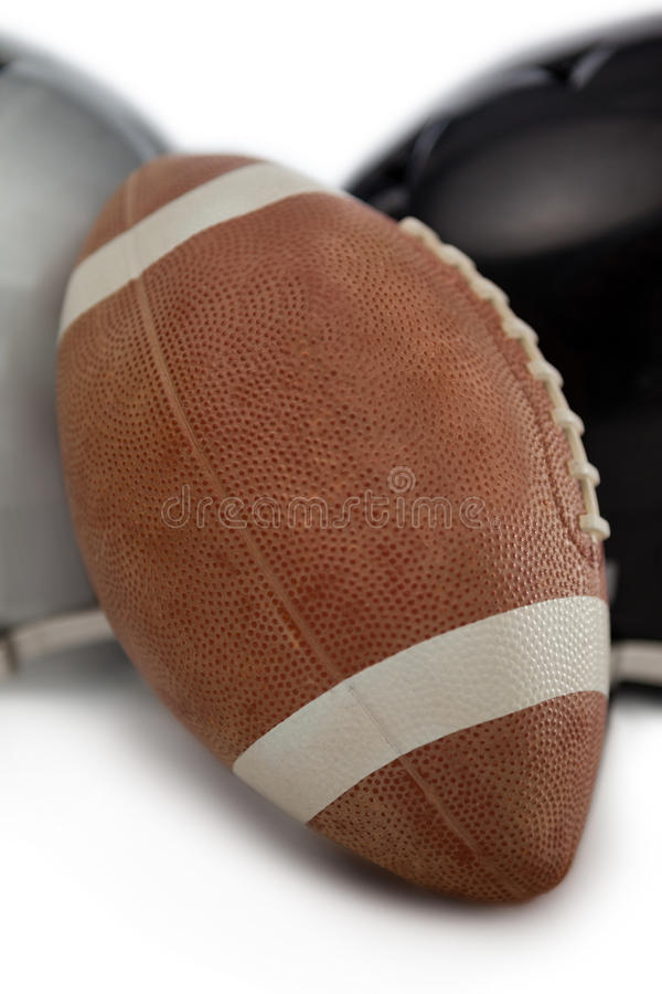 Close up of American football by sports helmet. On white background royalty free stock image
