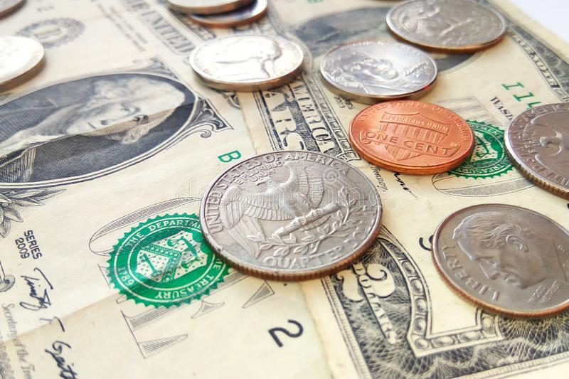 American quarter, dime and penny coins on dollars usa background. Close up American quarter, dime and penny coins on dollars usa background stock image