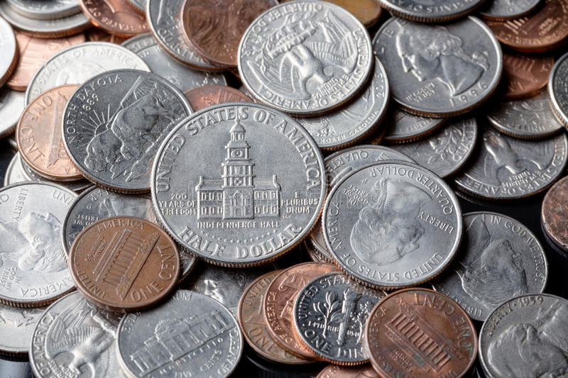 Close up of american US dollar coins as a background. Finance concept.  royalty free stock photography