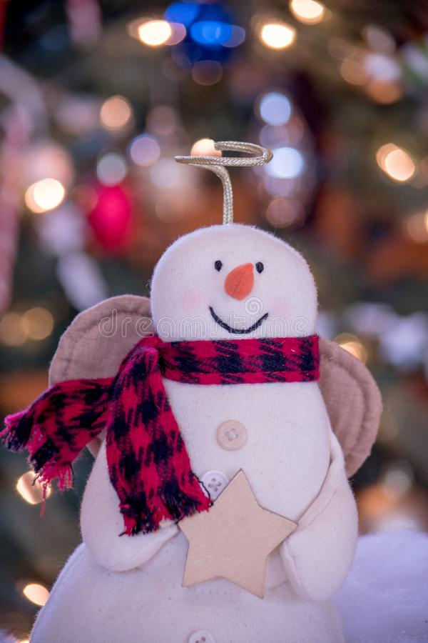 close up angel snowman by Christmas tree stock photos