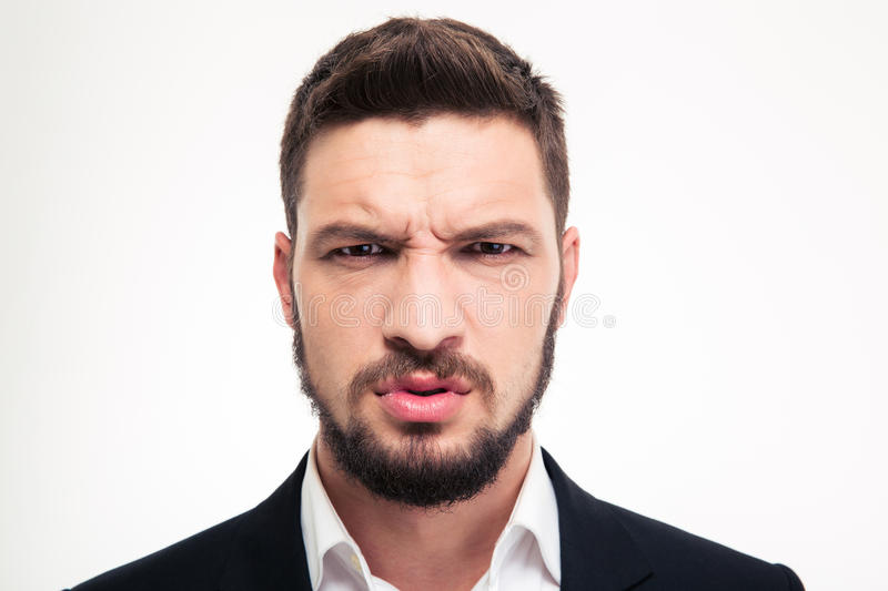 Close up of angry irritated bearded business man looking camera royalty free stock photo