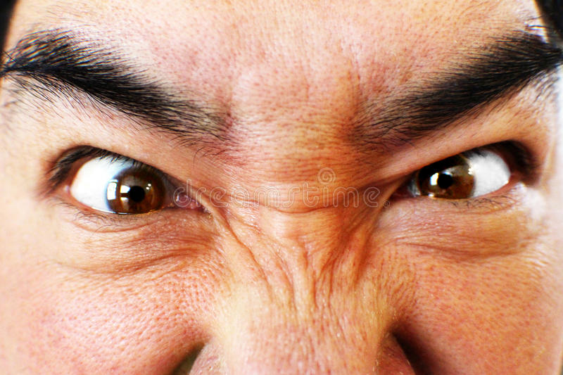 Close up of angry man's face stock photography