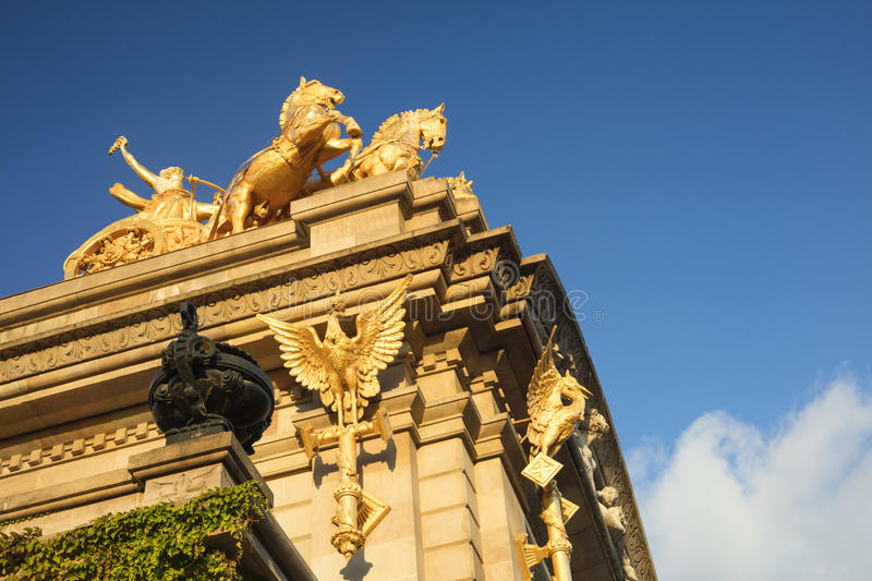 Close up of an antique golden monument in Citadel`s Park Parque. De la Ciudadela in Barcelona city, representing Aurora in a chariot with four horses royalty free stock photos