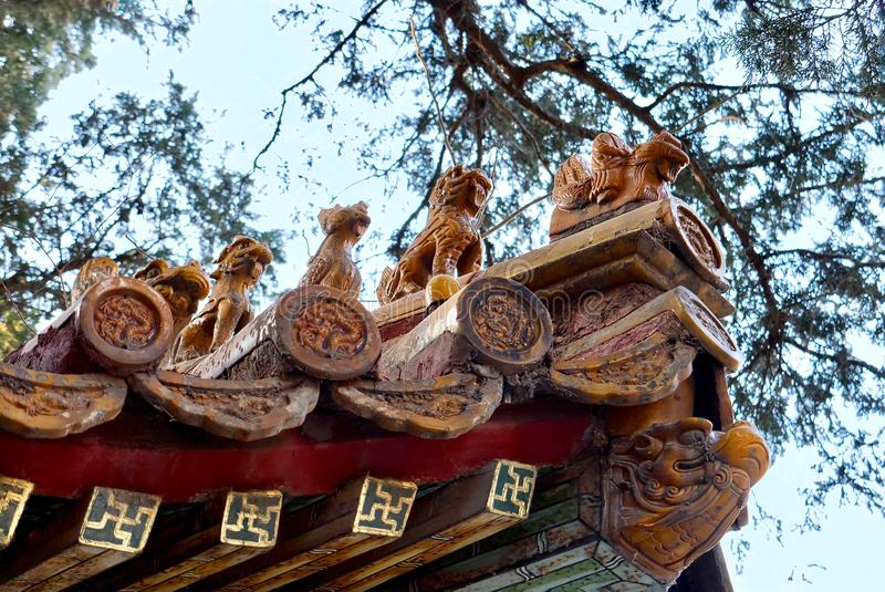 Close up of antique traditional Chinese roof figurines. The Imperial Palace in Beijing stock images