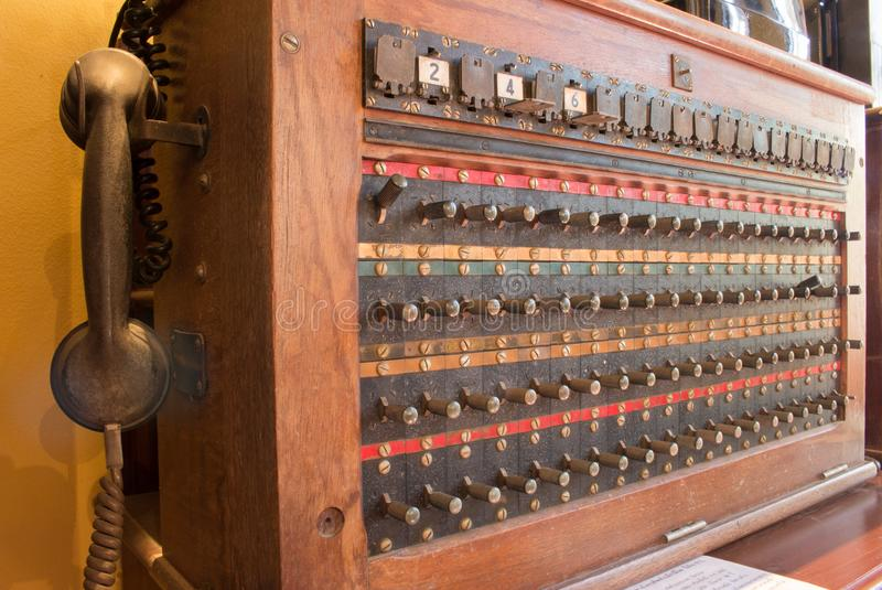 Close up of antique vintage telephone switch board, telecommunication wood box. stock photography