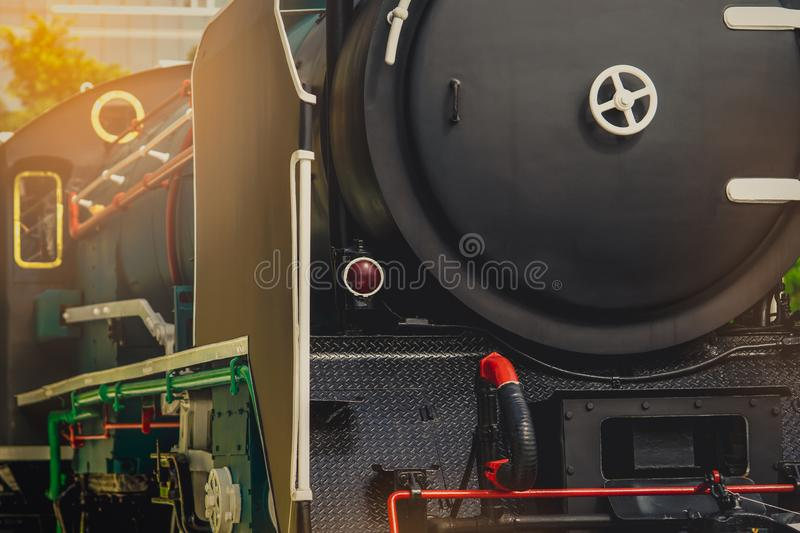 Close up antique vintage train locomotive. Old steam engine locomotive. Black locomotive. History industry. Historic steam train royalty free stock photos