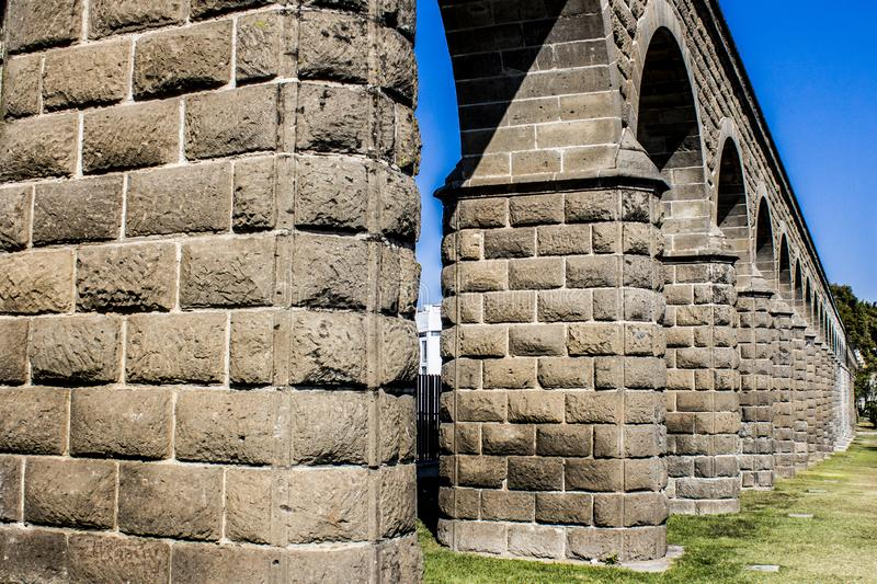 Close up of the arches of a stone aqueduct. On a wonderful sunny day with an intense blue sky in Guadalajara Jalisco Mexico royalty free stock photos