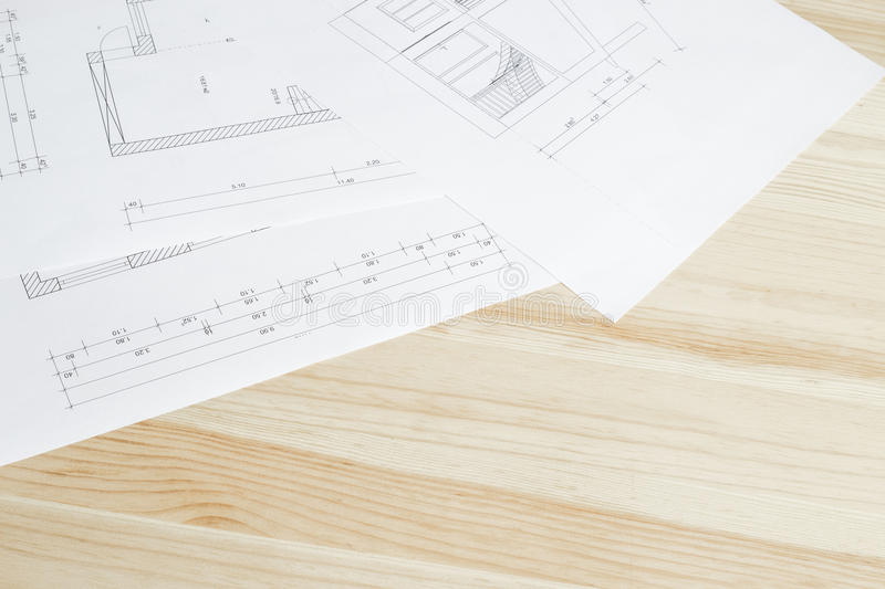Close-up of architects blueprint. Close-up of architects blueprint over wooden table royalty free stock photography