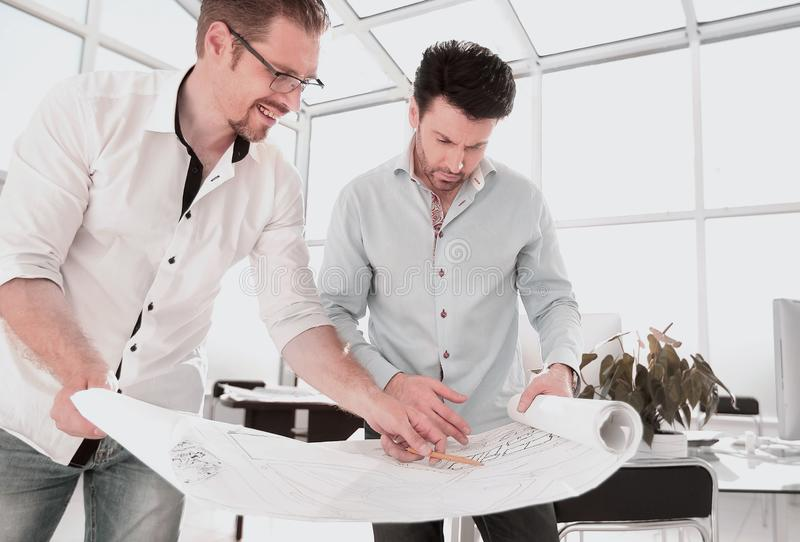 Close up.architects discuss sketches of the new project stock images