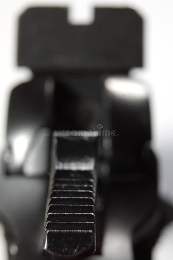 Close up armado do revólver foto de stock