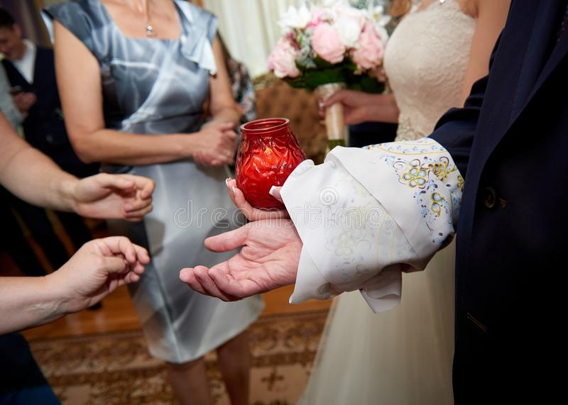 Tying arms of newlywed russian wedding tradition. Close up arms of bride and groom tied with rushnyk or embroided towel for Russian wedding traditio royalty free stock photos