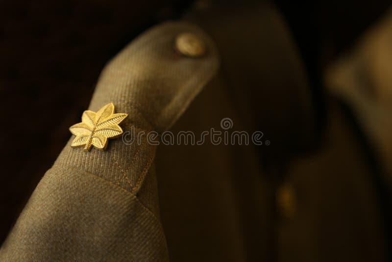 World War I uniform. Close up of Army major`s pin on the shoulder of a World War I Army uniform stock images