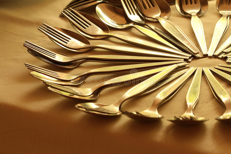 Close-up of arranging spoon and fork royalty free stock image