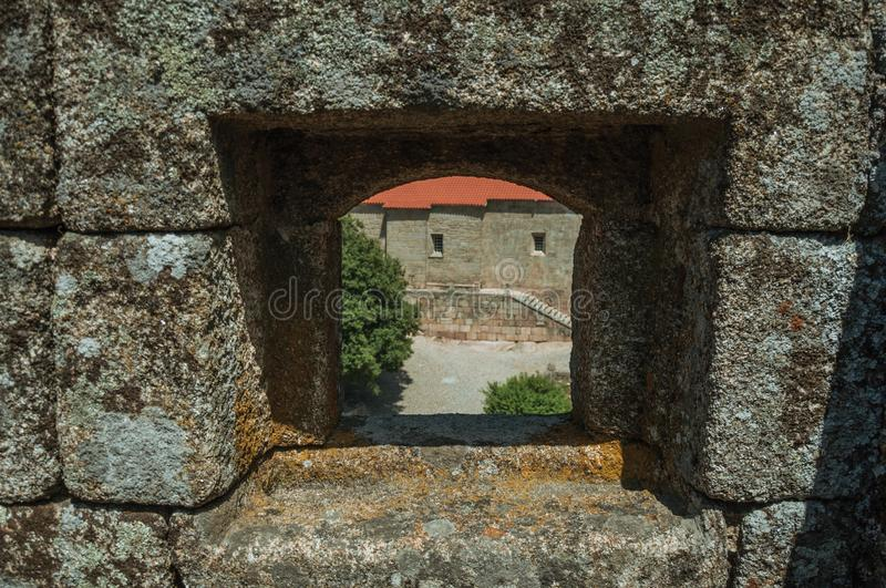 Close-up of arrow slit on stone wall of castle royalty free stock photo