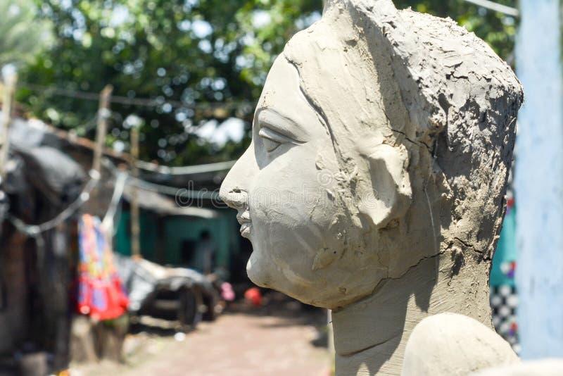 Close up Art model of Maa Durga pratima face. Goddess Durga sculpture made of clay during famous Durga Pooja Celebration. Taken stock photography