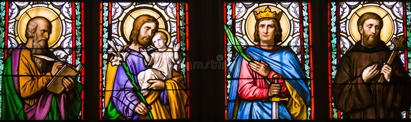 Close-up of art nouveau stained glass window by Alfons Mucha, St. Vitus Cathedral, Prague castle, Czech Republic. St.Luke, St. Joseph, St. Sigismund, St royalty free stock photo