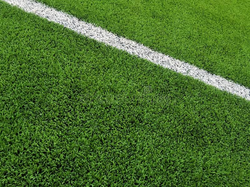 Artificial grass Field with white line background stock photo