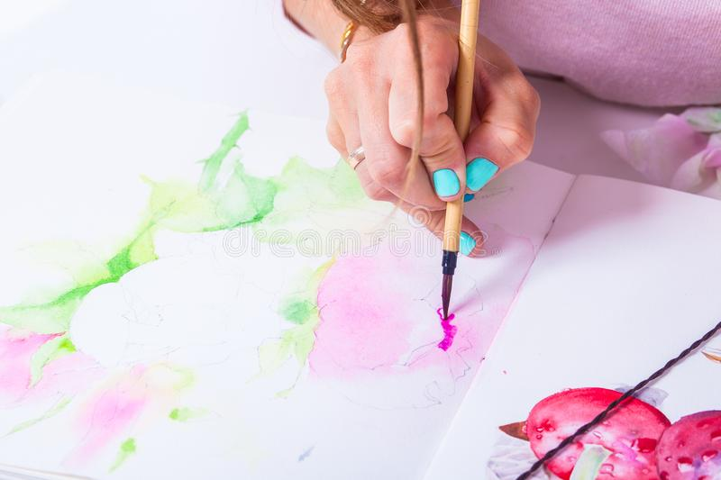 Close-up of the artist draws stock image